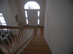Hardwood stairs and floors, entrance doors